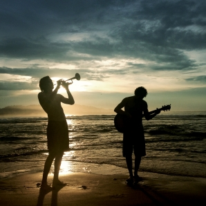 2 guys jamming on the beach - 6pm