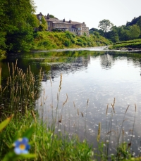 View across the serene River Hodder to the Inn at Whitewell (forget-me-not in the foreground)