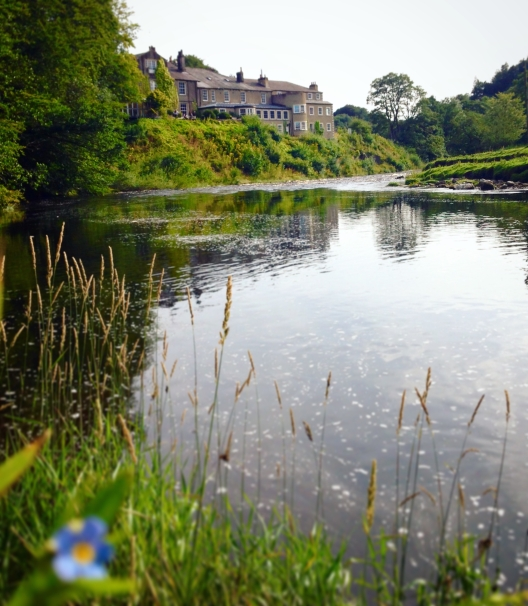 View across the serene River Hodder to the Inn at Whitewell
